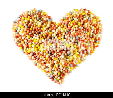 Heart shape made from 100's and 1000's sugar balls. - Stock Image