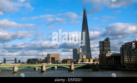 Cityscape view of the Shard building, Southwark Bridge and Tower Bridge on the River Thames in Central London England - Stock Image