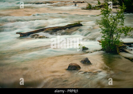 Fallen Log With Blurry Water Niagara River, New York USA - Stock Image