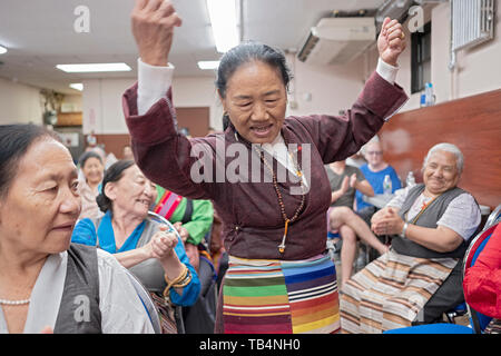 A Nepalese  women dances in the aisles at a concert of Himalayan music at the Sherpa Buddhist temple in Queens , New York City. - Stock Image