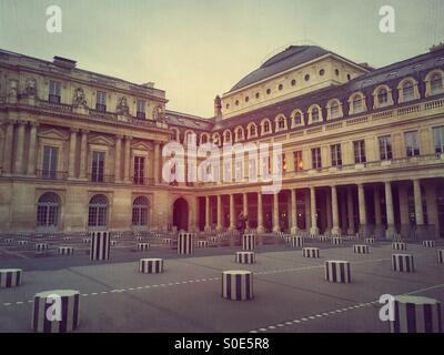View of main courtyard at Place du Palais-Royal in Paris, France. Les Deux Plateaux installation by Daniel Buren - Stock Image