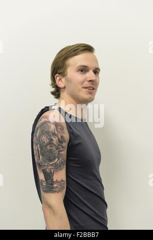 Garden City, New York, USA. September 13, 2015. KRISTJAN VALDIMARSSON, from Akureyri, Iceland, displays the tattoo - Stock Image