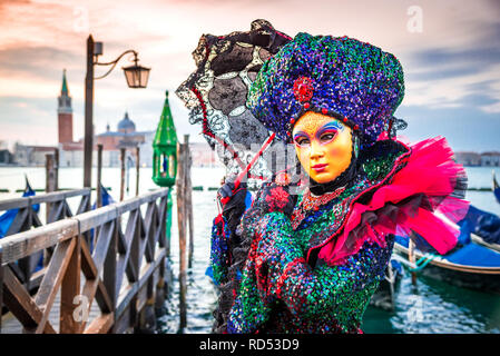 Venice, Carnival of Venice with beautiful mask at Piazza San Marco and Grand Canal, Italy - Stock Image