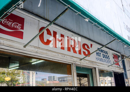 Exterior sign over the entrance to Chris Famous Hot Dogs restaurant or lunch counter a local landmark in Montgomery Alabama, USA. - Stock Image