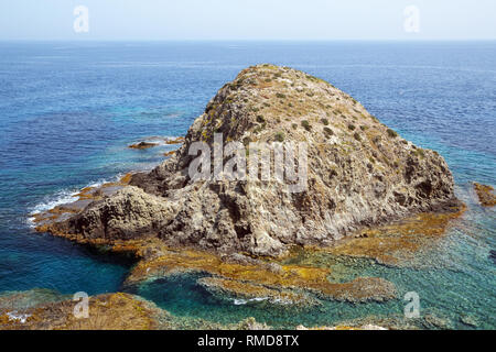 Isla del Moro is small island/headland in the Cabo de Gata Natural Park (Spain) close to the small, fishing village of Isleta del Moro. - Stock Image