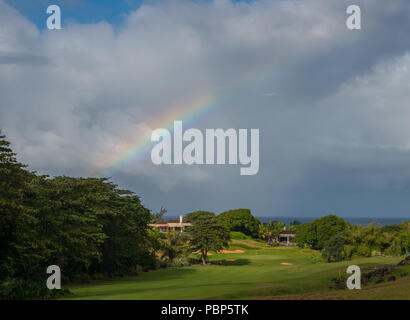 Rainbow over golf course - Stock Image