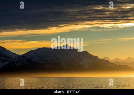 Greenland. Kong Oscar Fjord. Sunset over the calm water of the fjord. - Stock Image