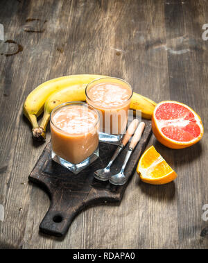 Fresh fruit smoothie . On a wooden table. - Stock Image