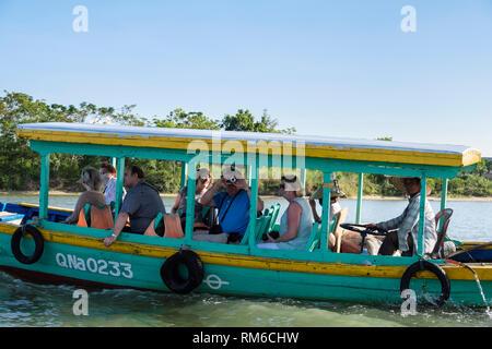 Tourists aboard boat sailing on Thu Bon River tour. Hoi An, Quảng Nam Province, Vietnam, Asia - Stock Image