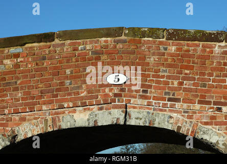 A sign say '5' on a canal bridge - Stock Image