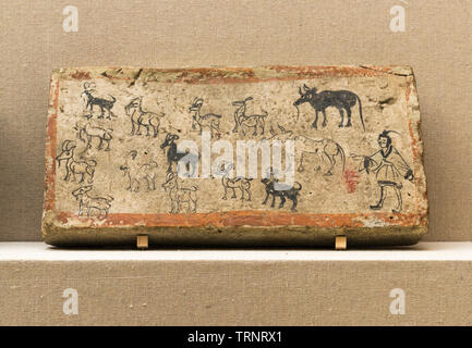 Painted Mural Brick with a Man Herding. 220 AD - 420 AD (Wei & Jin Dynasties). Unearthed at Tomb No.5, Xincheng Village, Jiayuguan, Gansu, 1972 - Stock Image