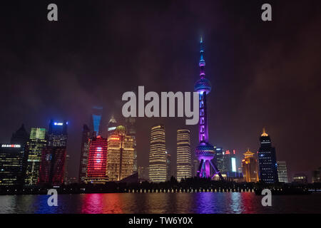 Night view of Oriental Pearl TV Tower and high rises by Huangpu River, Pudong, Shanghai, China - Stock Image