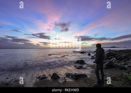 Mousehole, Cornwall, UK. 11th Feb, 2019. UK Weather. Colourful sunrise at Mousehole this morning. no sign of the wind from the recent stork Erik. Credit: Simon Maycock/Alamy Live News - Stock Image