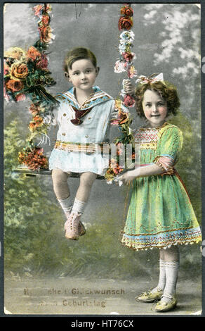 GERMANY - CIRCA 1914: A greeting postcard printed in Germany, shows a happy girl with a boy. The inscription in - Stock Image