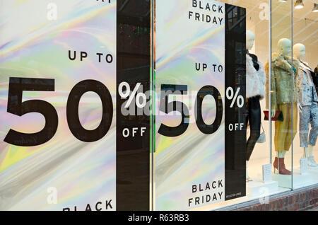 Black Friday signs on shop window England UK United Kingdom GB Great Britain - Stock Image