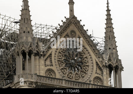 PARIS, FRANCE - 19 APRIL 2019 Notre Dame cathedral, after the timber roof caught fire. Scorched marks showing the damage to the stone work., and the m - Stock Image