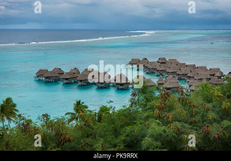 Over the water bungalows at the Sofitel la Ora Beach Resort Moorea, Tahiti, French Polynesia - Stock Image