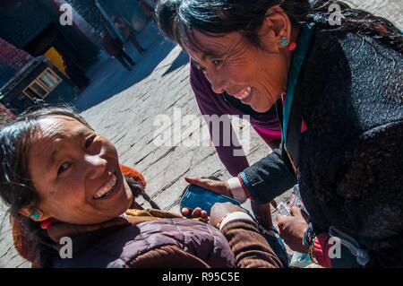 Two Tibetan women visiting Sakya Monastery, western Tibet, China - Stock Image