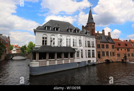 Scenic city view of Bruges canal with beautiful medieval Flemish colored houses . - Stock Image