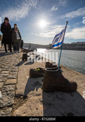 Jewish memorial shoes with Jewish flag on the Danube bank Budapest, Hungary - Stock Image