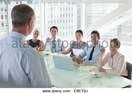 Business people sitting in meeting - Stock Image