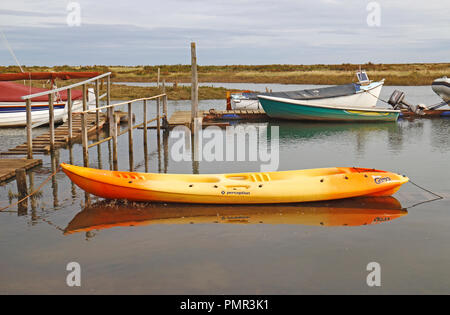 A Wavesport Perception Scooter Gemini double sit on top kayak moored in a creek on the North Norfolk coast at Morston, Norfolk, England, UK, Europe. - Stock Image