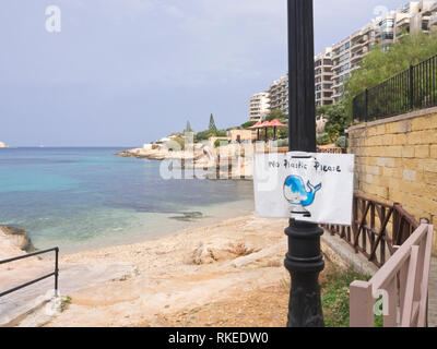 'No plastic please' humorous but important sign for environmental protection on the beach and coastal promenade in Sliema Malta - Stock Image