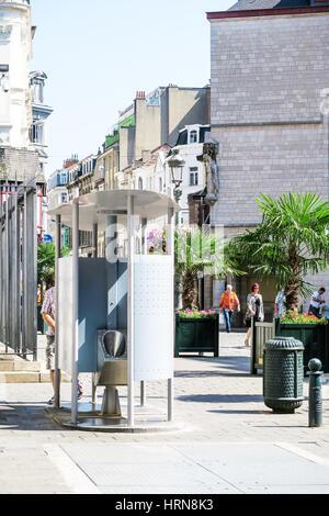 Very public toilets in Brussels, Belgium. - Stock Image