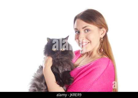 Pretty young woman in pink blouse holding black cat on white background - Stock Image