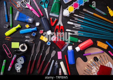 Back to School Concept with Stationery Supplies on Blackboard - Stock Image
