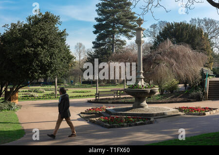 Abbey Gardens Bury St Edmunds, view in spring of the gardens and a  Victorian fountain and sundial(1870) sited in the park's southwest corner, Suffolk - Stock Image