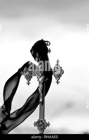 Crucifix neath the black veil - religious procession - Stock Image