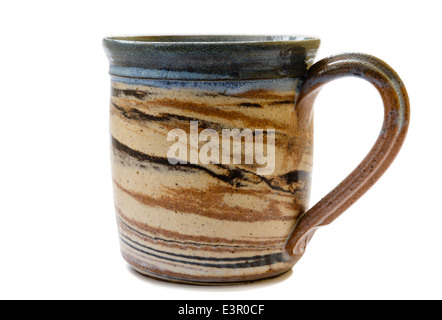 Rustic patterned pot coffee mug isolated on a white background - Stock Image