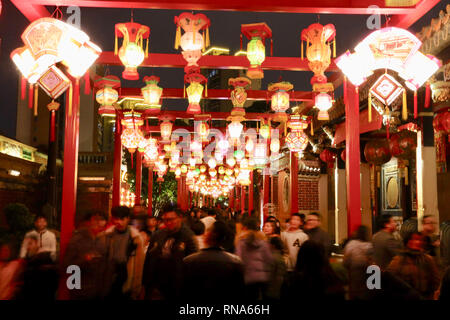 Jinjiang, China's Fujian Province. 17th Feb, 2019. Visitors look at festive lanterns at the Wudianshi historical community in Jinjiang, southeast China's Fujian Province, Feb. 17, 2019. More than 3,000 festive lanterns have been set in three dedicated zones in Jinjiang ahead of the Lantern Festival, which falls on Feb. 19 this year and marks the end of the Chinese Lunar New Year celebrations. Credit: Jiang Kehong/Xinhua/Alamy Live News - Stock Image