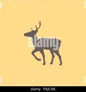 Vintage brown deer emblem on a yellow background. Grunge badge, typogrphic symbol suitable for T-shirts or print. Isolated vector illustration - Stock Image