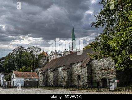 The tower spire of St. Olaf's church and the Tower behind Hattorpe are visible just outside the medieval city walls of Tallinn, Estonia. - Stock Image