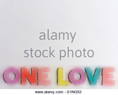 one love (phrase, rasta motto, acronym) - Stock Image