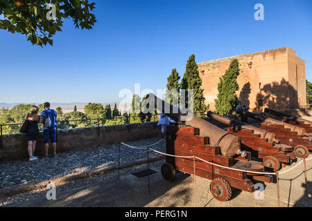 Canons at the Alhambra Palace Spain with tourists looking at the view - Stock Image