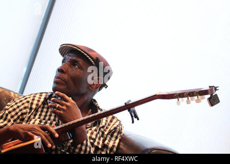 Zimbabwe musician Oliver Mutukudzi and Shingi Shoniwa  photocall ahead of the Hoza Festival 2012 'A Taste of Southern Africa that due for 17th August at the Indigo O2. Other artist to perform include Prudence Katomeni-Mbofana and Busi Ncube. - Stock Image