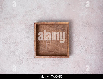 empty wooden box on concrete background. view from above. copy space - Stock Image