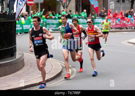 Thomas De Bock (BEL), leading from Robbie Simpson (GBR),  Colin Leak (USA) and  Nicholas Torry (GBR) in the Men's Elite 2019 London Matathon. They went on to finish  22nd, 23rd, 24th and 28th respectively  (Nicholas was 1st in the men's  40-44 category) - Stock Image