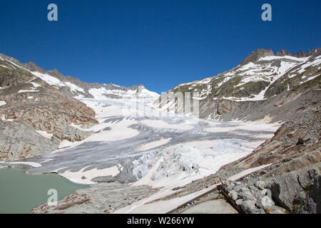 Rhone glacier, source of Rhone river, melting and retreating due to global warming. Rhone glacier is loosing up to 2 meters in length every year. - Stock Image