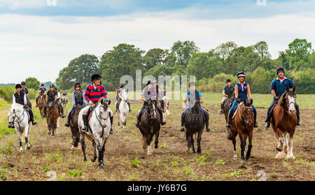 A group of people out riding horses on a late summers afternoon - Stock Image