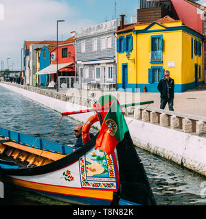 Aveiro, Portugal - April 28, 2019: Traditional boats on the canal in Aveiro, Portugal. Colorful Moliceiro boat rides in Aveiro are popular with touris - Stock Image