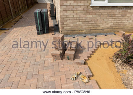 Installation of a blocked paved driveway - Stock Image