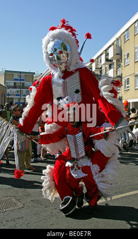 Red Indian Carnival Figure in the Notting Hill Carnival Parade 2009 - Stock Image