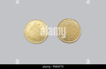Cartagena, Spain - September 14th, 2018: Gold spanish pieces of eight or Charles III escudos, minted in 1780 at ARQUA Museum, Spain - Stock Image