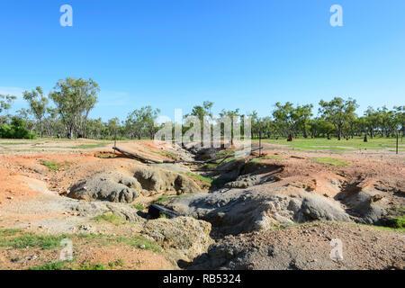 Soil erosion along a creekbed near Mt Surprise, Savannah Way, Queensland, QLD, Australia - Stock Image