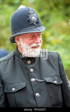 Woodhall Spa 1940s Festival - Policeman dressed in 1940s uniform with helmet - Stock Image