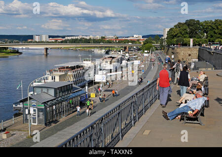 people on benches at Bruehl's Terrace over Terrassenufer waterfront, Dresden, Germany - Stock Image